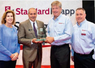 Standard-Knapp receives an award from PMMI for 125 years of excellence. (Left to right) Judy Smith, Standard-Knapp; Jim Pittas, PMMI; Mike Weaver and Mark Jehnings, Standard-Knapp.
