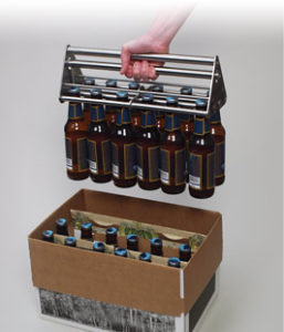 Hand packing full bottles